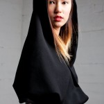 Li-Ann wears the Victoria Drape wool and leather jacket AW12